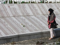 A student from the Netherlands contemplating the scores of names of victims
